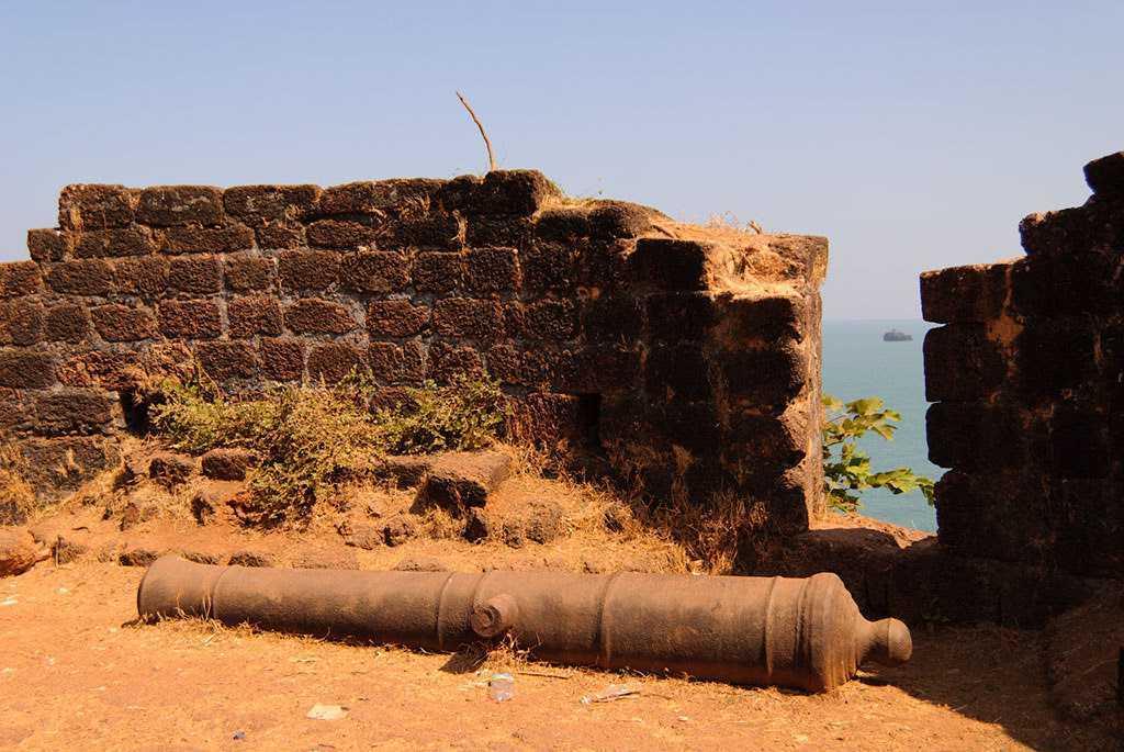 A canon lies at cabo de rama fort goa-fnbworld