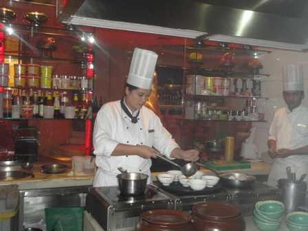 chef joy in kitchen-fnbworld