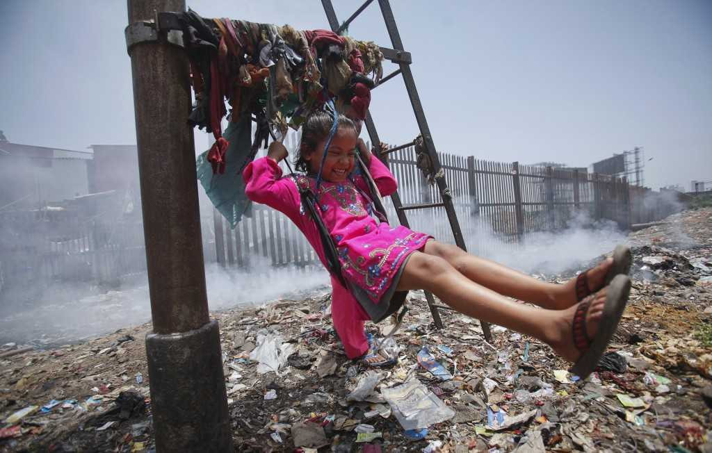 A child playing in garbage dump