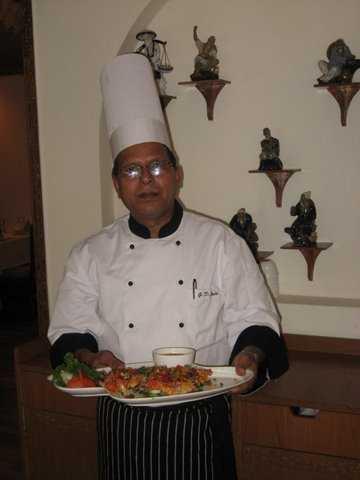 Chef  Joshi  with   sesame  tiger  prawns. Photo: Right  Impact  Media  Inc.