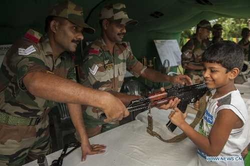 Indian army showing the gun to children-fnbworld
