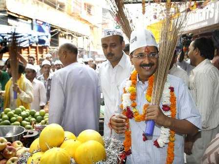 Arvind Kejriwal with party symbol broom